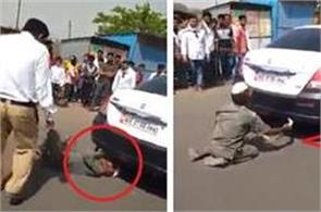 old man caught snake from cars silencer