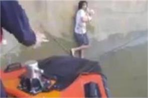 the young man jumped into the river to save the dog see video