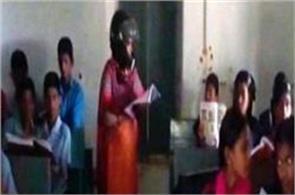 a school teacher teaching children wearing helmets