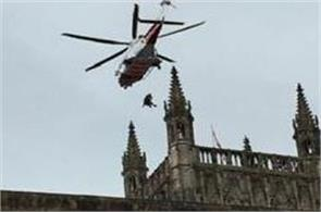 rescues unwell man from 300 ft top of the tower