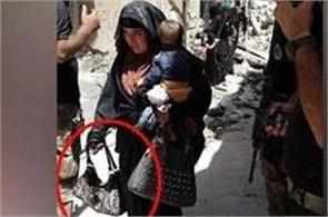 female isis suicide bomber cradling baby before pulling trigger