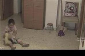 girl playing with doll and  suddenly something scary happens