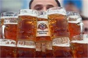 german taxman breaks record for carrying the most beer in one go