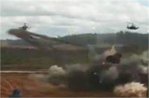 russian helicopter mistakenly fires at vehicles during war games