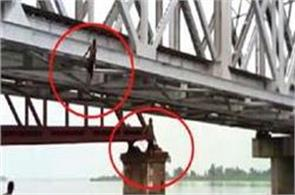 dangerous stunts of railway bridge  innocent people put their lives in this way