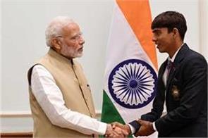 farmer s son organized history in archery pm modi congratulates