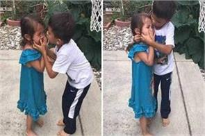 little boy helping his baby sister play basketball