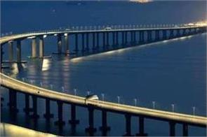 china s president xi jinping launches the world s longest sea bridge
