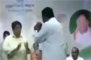 fight on stage between puducherry governor kiran bedi and aiadmk mla