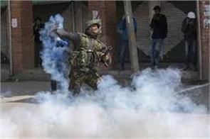 tear gas shell busted on protestors in kashmir