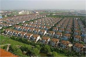 china s richest village has everything from five star hotels to helicopter taxis