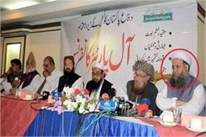pakistans real face imrans minister did stage sharing with hafiz saeed