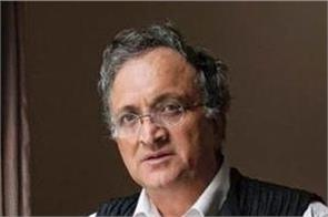 guha denies teaching at ahmedabad university