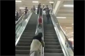 kids sliding on escalator in lahore airport