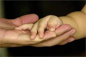 gay singaporean man wins right to adopt surrogate son