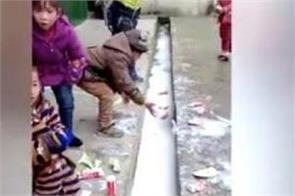chinese school children pour out free milk dairy company under investigation