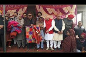 490 truck of punjab kesari relife distributed in swankha