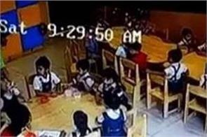 teacher taps the mouth to silence children