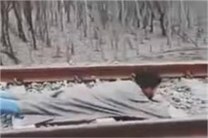 train passes above the young man lying on the track