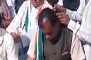 congress workers shaved his hair