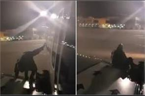 passenger climbed out of delayed jet  s emergency exit