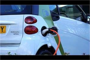big business question of how the electric vehicle will be charged