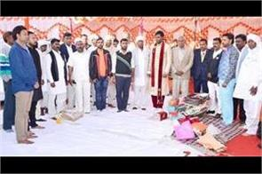 groom gives respect to national anthem