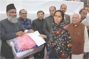 punjab kesari distribute reilfe amonf jammu kashmir firing victims