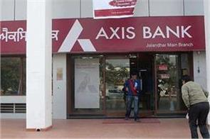 axis bank first quarterly deficit net income defected