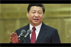 china committed to open economy jinping