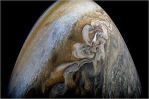 jupiter s moon detected a stormy atmosphere