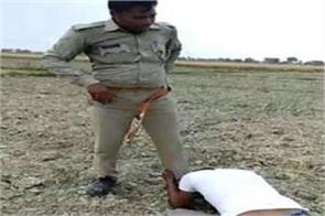 policeman first beaten then rubbing the nose on the shoes