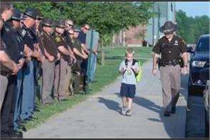 cops escort children to school after they lost their brave dad in a crash
