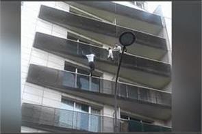 paris hero climbs up four storey apartment block to rescue boy