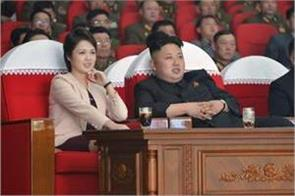 kim jong hit the photographer taking photograph of wife