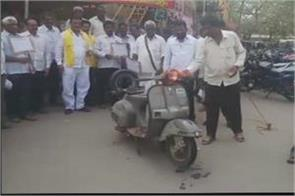 tdp workers fired scooters in protest against petrol and diesel