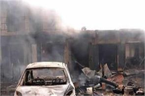 at least 60 people died in nigeria s two bomb blasts