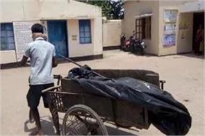 womans body carried in garbage trolley in odisha