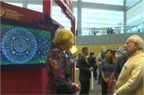 pm modi talks to robot woman in singapore