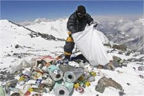 mount everest being transformed into a pile of waste dirt spread by ton