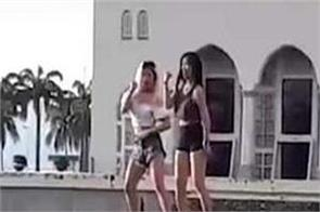 girls dance in front of mosque in malaysia