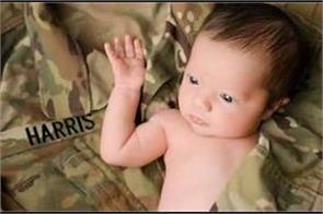 us newborn daughter of fallen hero held by soldiers in viral image