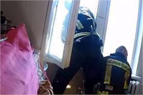 video shows firefighters rescuing suicidal man after he jumps out of window