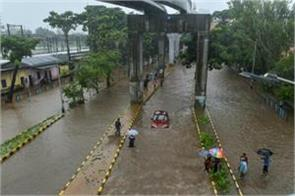 rains in mumbai rail track submerged due to waterfalls