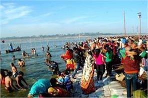 faithful devotees plunge into sangam