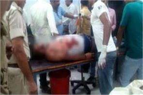 two killed including police station officer