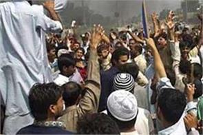 protest against pak over increasing terrorist activities in pok