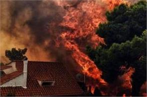 greece wildfires nearly 50 dead in holiday area