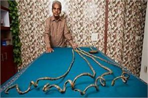 indian man persuaded to cut his nails after 66 years