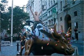 putin sitting on a charging bull on wall street in new york